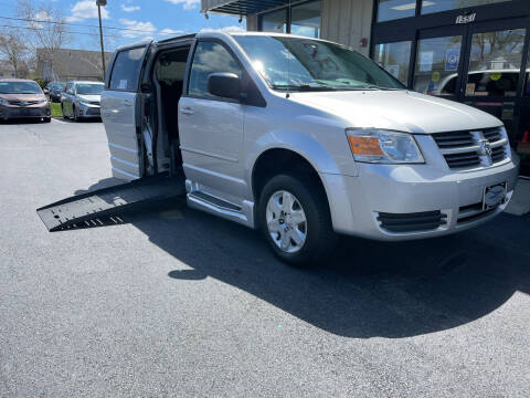 2009 Dodge Grand Caravan for sale at Adaptive Mobility Wheelchair Vans in Seekonk MA