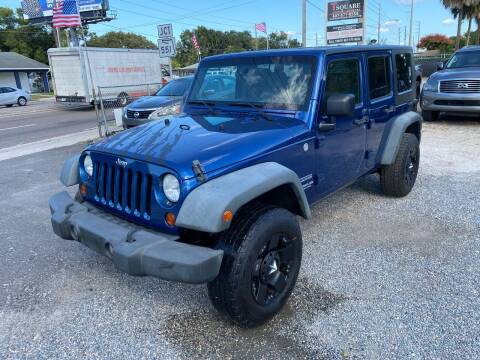 2010 Jeep Wrangler Unlimited for sale at Velocity Autos in Winter Park FL
