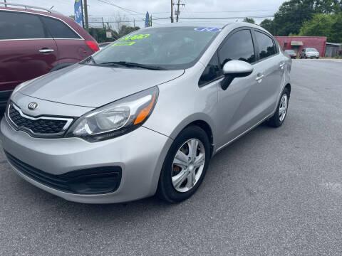 2014 Kia Rio for sale at Cars for Less in Phenix City AL