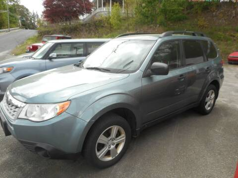 2013 Subaru Forester for sale at Ricciardi Auto Sales in Waterbury CT
