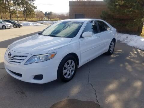 2011 Toyota Camry for sale at QUEST MOTORS in Englewood CO