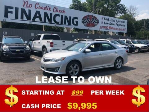 2012 Toyota Camry for sale at Auto Mart USA in Kansas City MO