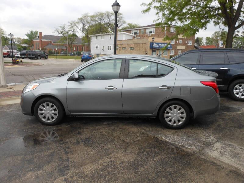 2013 Nissan Versa for sale at Grand River Auto Sales in River Grove IL