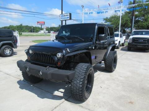 2013 Jeep Wrangler for sale at Lone Star Auto Center in Spring TX