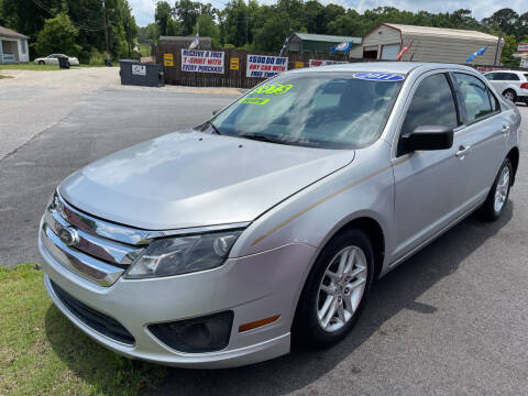 2011 Ford Fusion for sale at Cars for Less in Phenix City AL