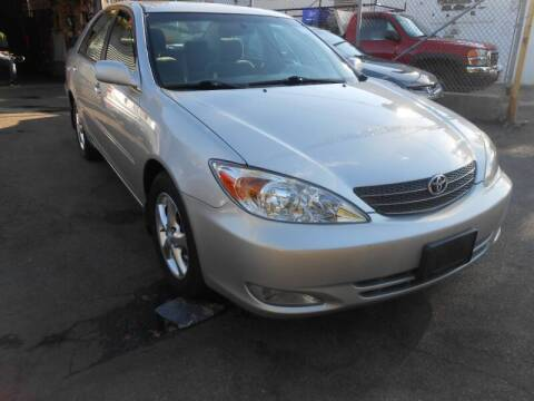 2004 Toyota Camry for sale at N H AUTO WHOLESALERS in Roslindale MA