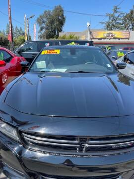 2015 Dodge Charger for sale at Rey's Auto Sales in Stockton CA
