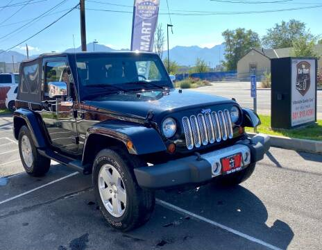 2010 Jeep Wrangler for sale at The Car-Mart in Murray UT