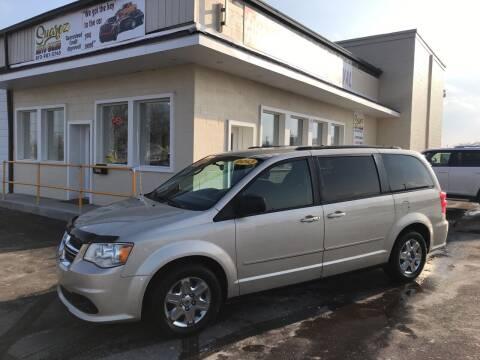 2013 Dodge Grand Caravan for sale at Suarez Auto Sales in Port Huron MI