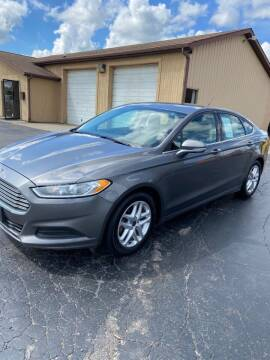 2014 Ford Fusion for sale at DAVE KNAPP USED CARS in Lapeer MI