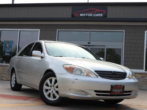 2002 Toyota Camry for sale at CK MOTOR CARS in Elgin IL