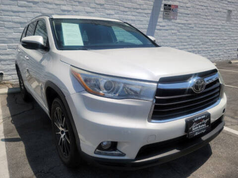 2014 Toyota Highlander for sale at ADVANTAGE AUTO SALES INC in Bell CA