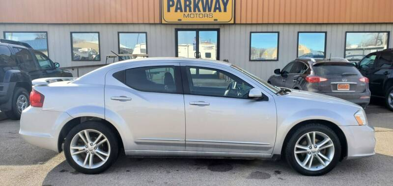 2012 Dodge Avenger for sale at Parkway Motors in Springfield IL