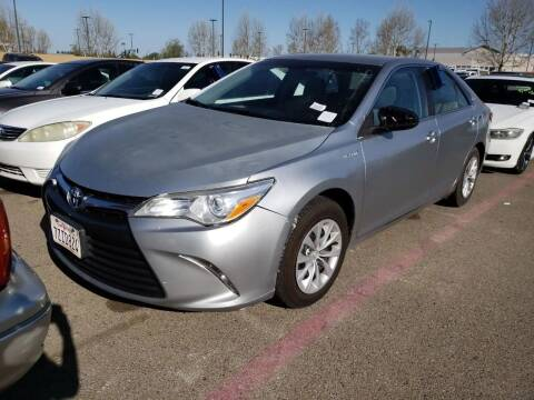 2015 Toyota Camry Hybrid for sale at MCHENRY AUTO SALES in Modesto CA
