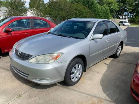 2004 Toyota Camry for sale at Getsinger's Used Cars in Anderson SC