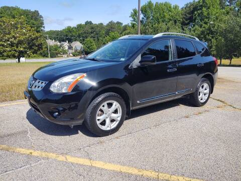 2011 Nissan Rogue for sale at WIGGLES AUTO SALES INC in Mableton GA
