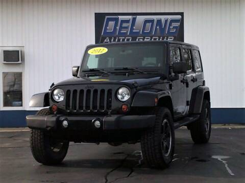 2012 Jeep Wrangler Unlimited for sale at DeLong Auto Group in Tipton IN