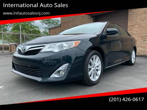 2014 Toyota Camry for sale at International Auto Sales in Hasbrouck Heights NJ