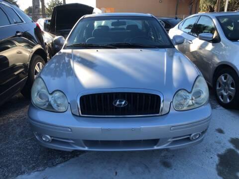 2004 Hyundai Sonata for sale at Louie's Auto Sales in Leesburg FL