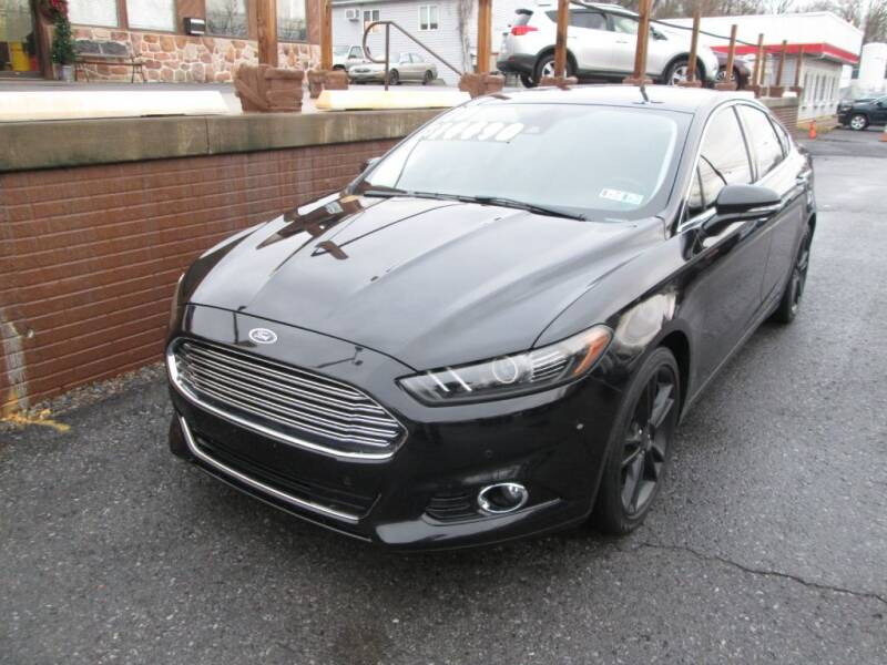 2013 Ford Fusion for sale at WORKMAN AUTO INC in Pleasant Gap PA
