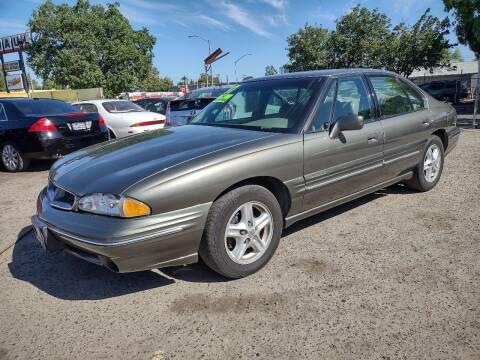 1997 Pontiac Bonneville for sale at Larry's Auto Sales Inc. in Fresno CA