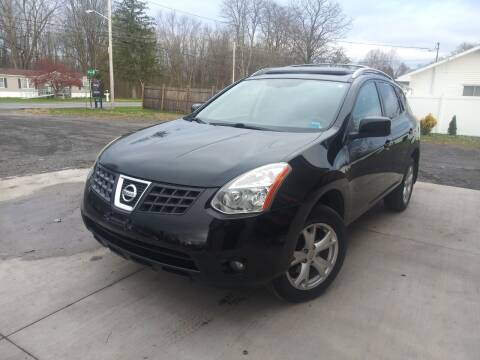 2009 Nissan Rogue for sale at John's Auto Sales & Service Inc in Waterloo NY
