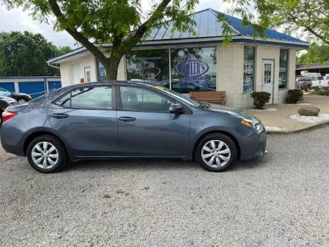 2014 Toyota Corolla for sale at Wallers Auto Sales LLC in Dover OH
