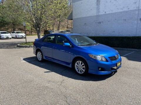 2010 Toyota Corolla for sale at Select Auto in Smithtown NY