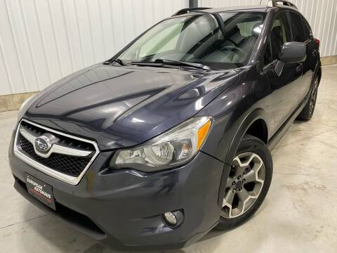 2014 Subaru XV Crosstrek for sale at EUROPEAN AUTOHAUS, LLC in Holland MI