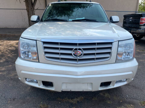 2004 Cadillac Escalade for sale at GO GREEN MOTORS in Lakewood CO