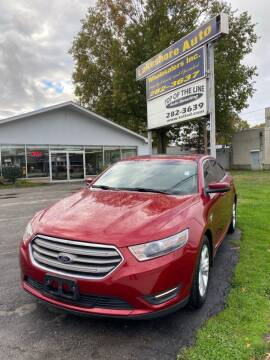 2013 Ford Taurus for sale at Lakeshore Auto Wholesalers in Amherst OH