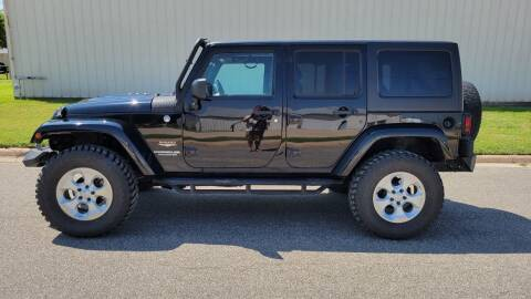 2014 Jeep Wrangler Unlimited for sale at TNK Autos in Inman KS