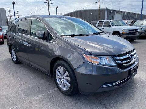 2014 Honda Odyssey for sale at New Wave Auto Brokers & Sales in Denver CO