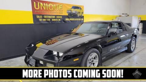 1987 Chevrolet Camaro for sale at UNIQUE SPECIALTY & CLASSICS in Mankato MN