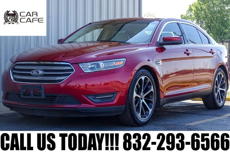 2014 Ford Taurus for sale at CAR CAFE LLC in Houston TX