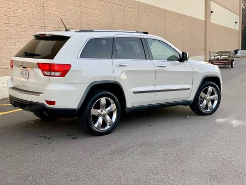 2011 Jeep Grand Cherokee for sale at XCELERATION AUTO SALES in Chester VA