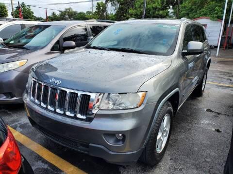 2012 Jeep Grand Cherokee for sale at America Auto Wholesale Inc in Miami FL