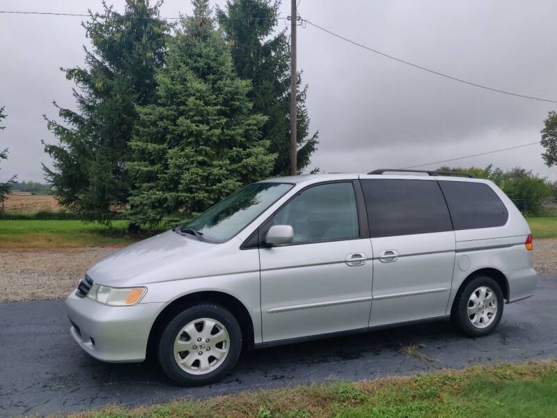 2004 Honda Odyssey for sale at Carmart Auto Sales Inc in Schoolcraft MI