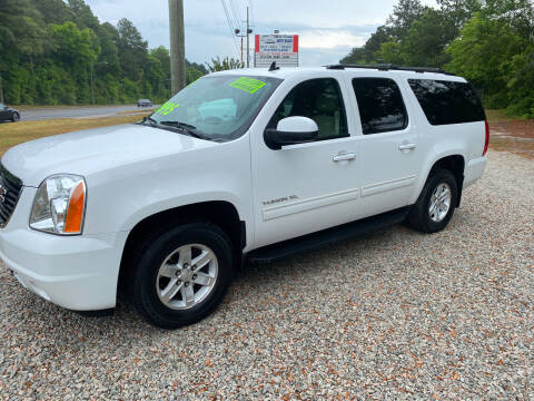 2013 GMC Yukon XL for sale at TOP OF THE LINE AUTO SALES in Fayetteville NC