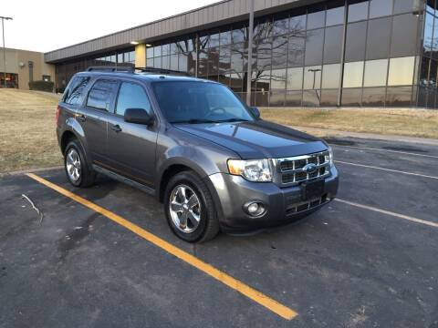 2009 Ford Escape for sale at QUEST MOTORS in Englewood CO
