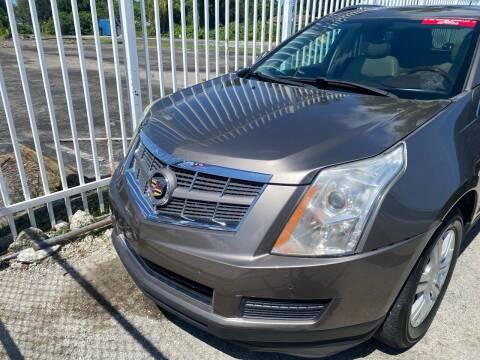 2012 Cadillac SRX for sale at America Auto Wholesale Inc in Miami FL