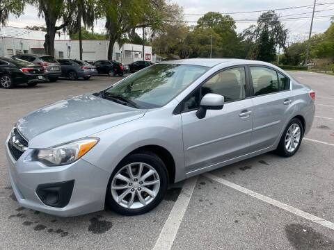 2012 Subaru Impreza for sale at CHECK  AUTO INC. in Tampa FL