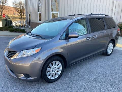 2011 Toyota Sienna for sale at AMERICAR INC in Laurel MD