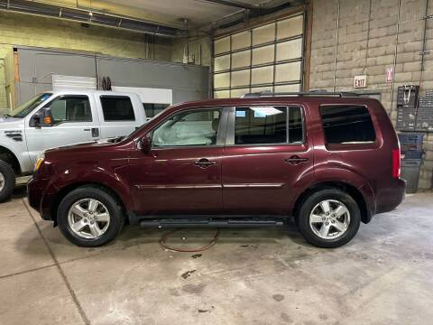 2011 Honda Pilot for sale at Newport Auto Group in Austintown OH