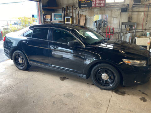 2014 Ford Taurus for sale at Ogden Auto Sales LLC in Spencerport NY