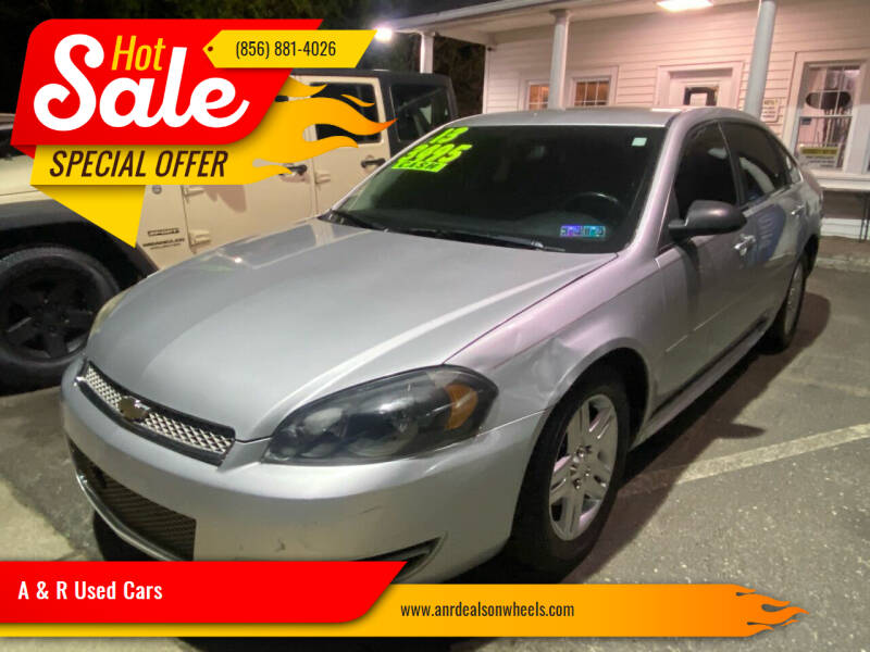 2013 Chevrolet Impala for sale at A & R Used Cars in Clayton NJ