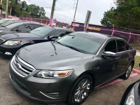 2011 Ford Taurus for sale at Fast and Friendly Auto Sales LLC in Decatur GA