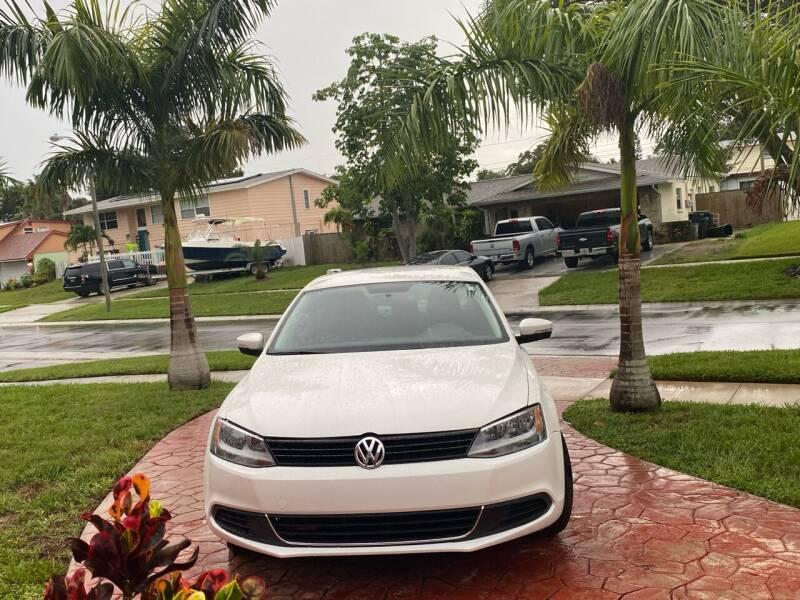 2012 Volkswagen Jetta for sale at ONYX AUTOMOTIVE, LLC in Largo FL