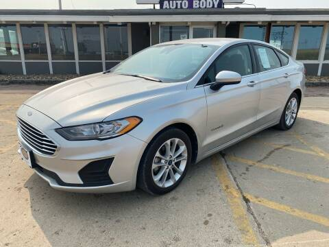 2019 Ford Fusion Hybrid for sale at BERG AUTO MALL & TRUCKING INC in Beresford SD