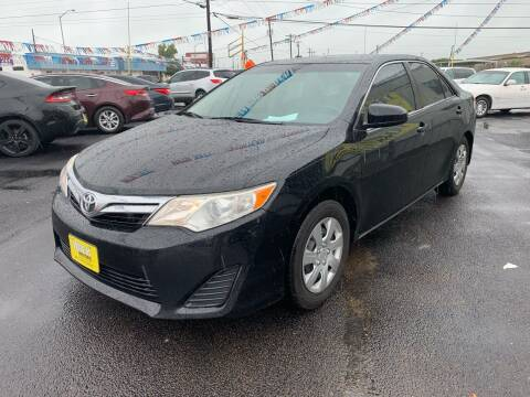 2014 Toyota Camry for sale at Rock Motors LLC in Victoria TX